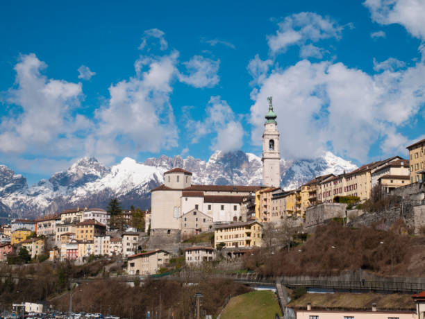 View of Belluno on a bright sunny day, during winter time stock photo