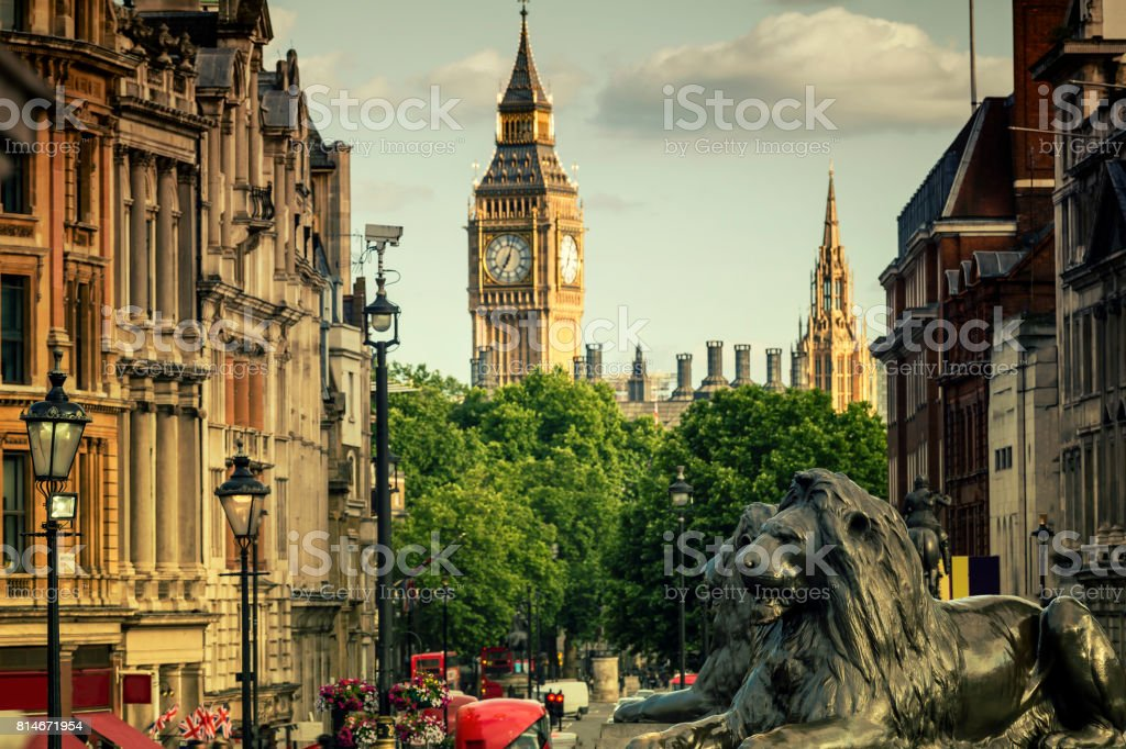 View of Big Ben and Whitehall from Trafalgar Square in London at sunset stock photo