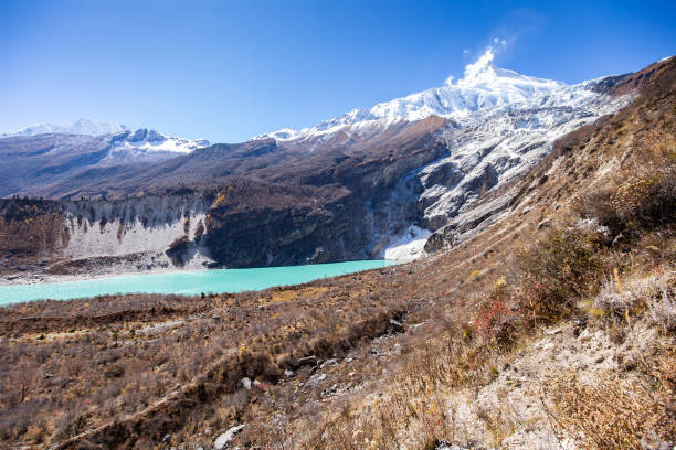 View of Birendra Lake under Manaslu glacier stock photo
