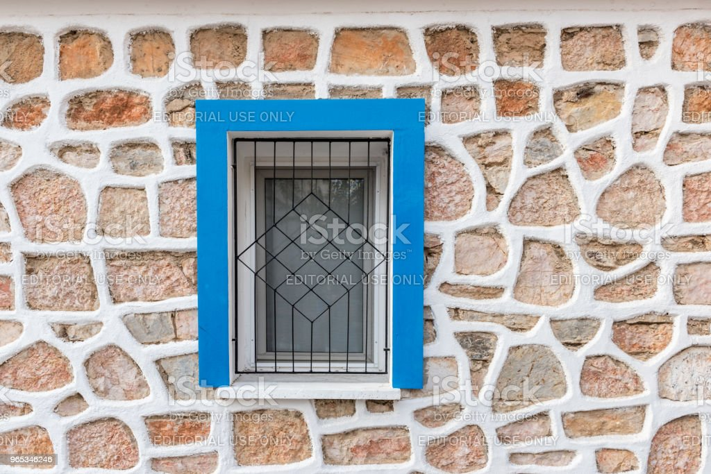 View of blue and white wooden window with white stone zbiór zdjęć royalty-free