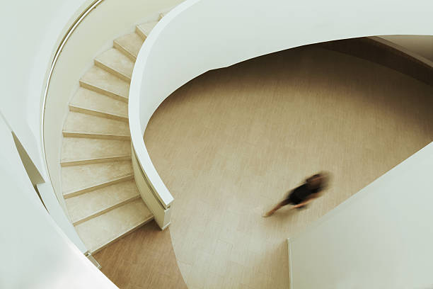 View of blurred person walking towards staircase in building stock photo