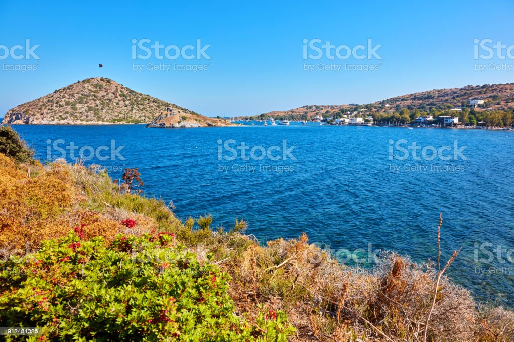 View of Bodrum Gumusluk bay, flag hill and rabbit island stock photo