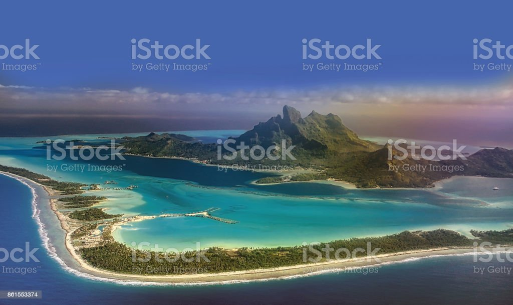 View of Bora Bora island from airplane window during landing stock photo