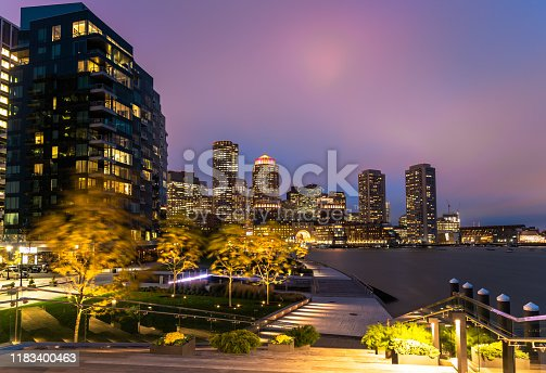 Photo of Boston skyline as seen from the Seaport district watefront on a windy night