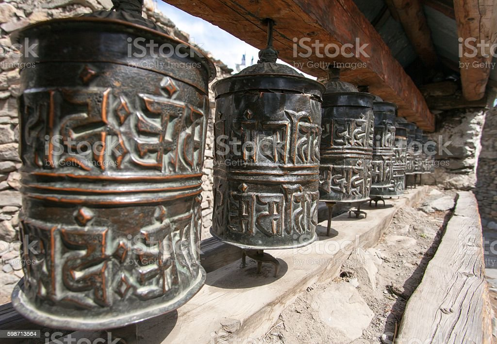 view of Buddhist many prayer wheels stock photo