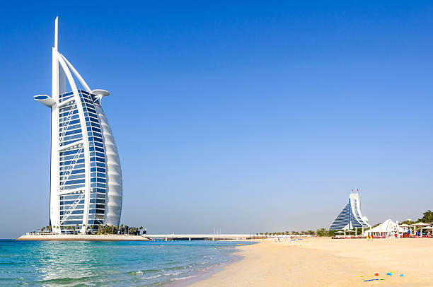 View of Burj Al Arab hotel from the Jumeirah beach Dubai, United Arab Emirates - January 08, 2012: View of Burj Al Arab hotel from the Jumeirah beach. Burj Al Arab is one of the Dubai landmark, and one of the world's most luxurious hotels with 7 stars. dubai stock pictures, royalty-free photos & images