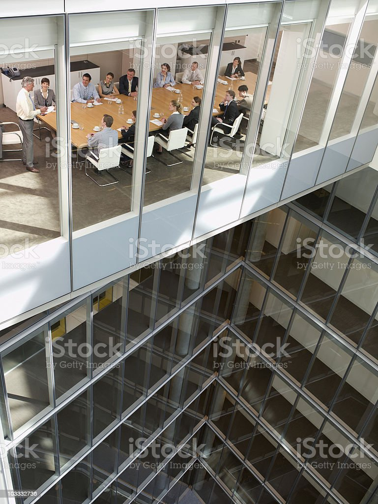 View of business people in conference room of highrise building stock photo