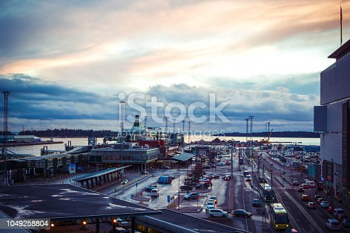 istock View of business port with international transportation with shipping cargo, ships, cruise liners, car parking in morning, Helsinki, Finland 1049258804
