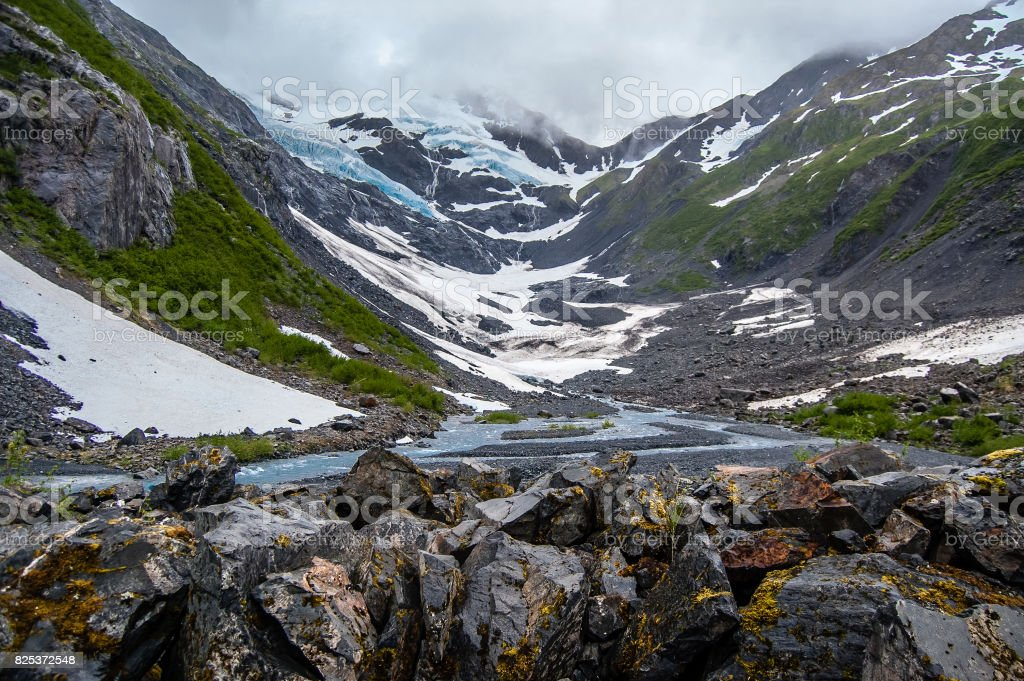 View of Byron Glacier and Byron creek and rocks stock photo