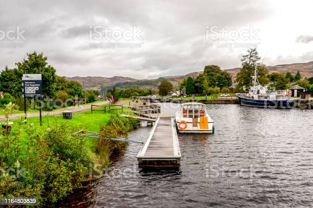 View of caledonian canal with a couple of boats parked near locks picture id1164803839?b=1&k=6&m=1164803839&s=612x612&h=grzhxpvfxwdbidxfvlhzge7dpkyenxj5gym8pz41htm=