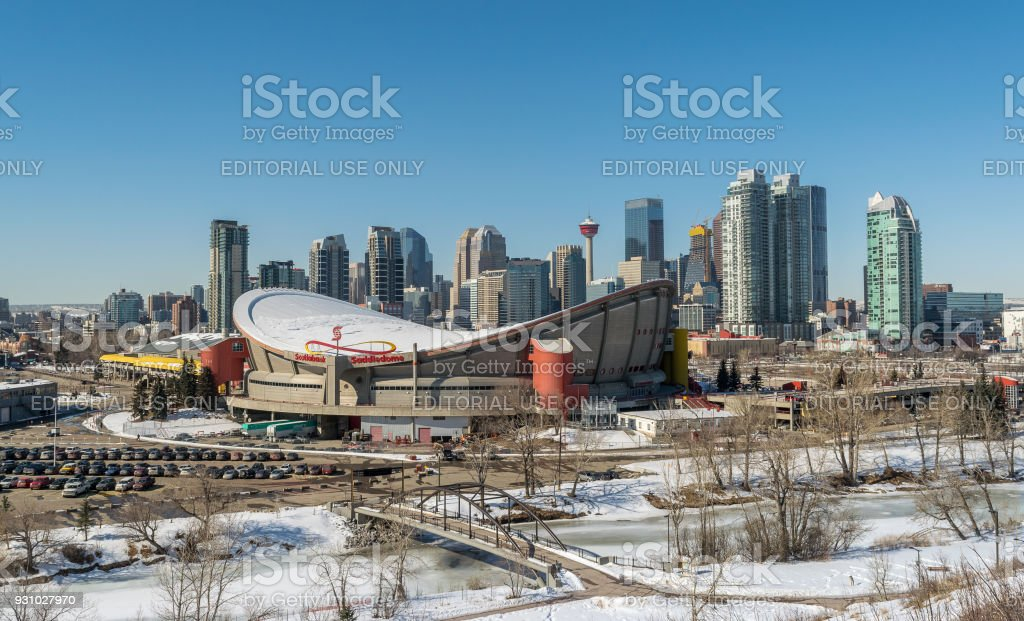 CALGARY - March 11. 2018: View of Calgary downtown and Scotiabank Saddledome during the sunny winter day stock photo