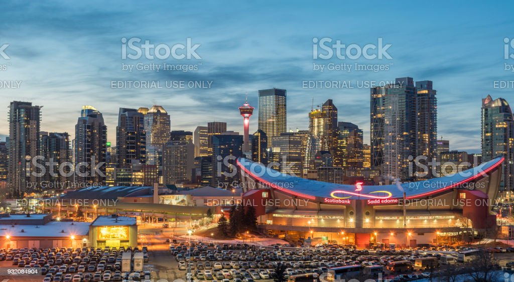 CALGARY, Canada - March 13. 2018: View of Calgaryskyline and Scotiabank Saddledome in the evening