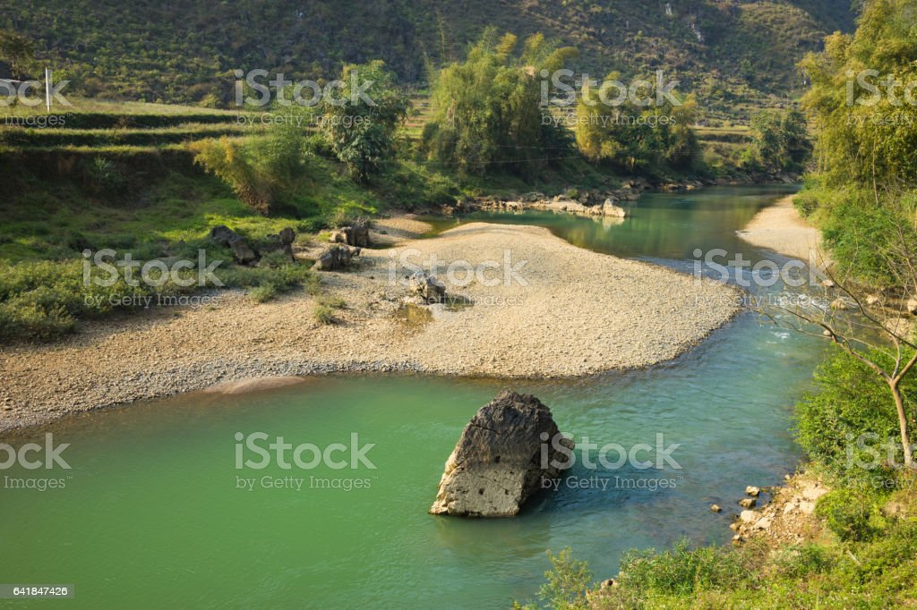 View of calm river under morning sunlight stock photo
