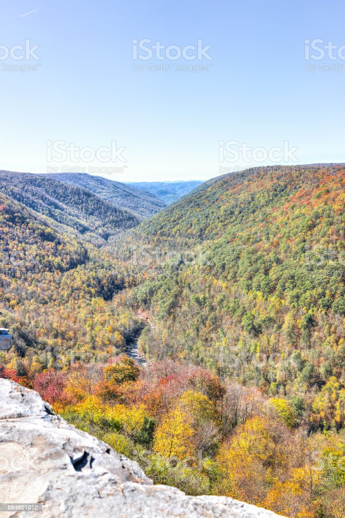 View of canaan valley mountains in Blackwater falls state park in West Virginia during colorful autumn fall season with yellow foliage on trees, rock cliff at Lindy Point stock photo