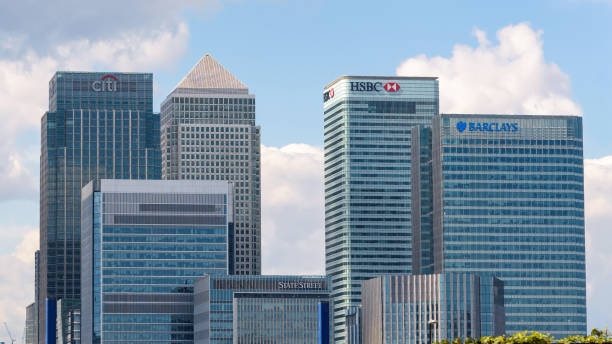 View of Canary Wharf skyscrapers in London London, UK - May 1, 2018: Modern skyscrapers of Canary Wharf, one of the main financial centres of the United Kingdom hsbc stock pictures, royalty-free photos & images