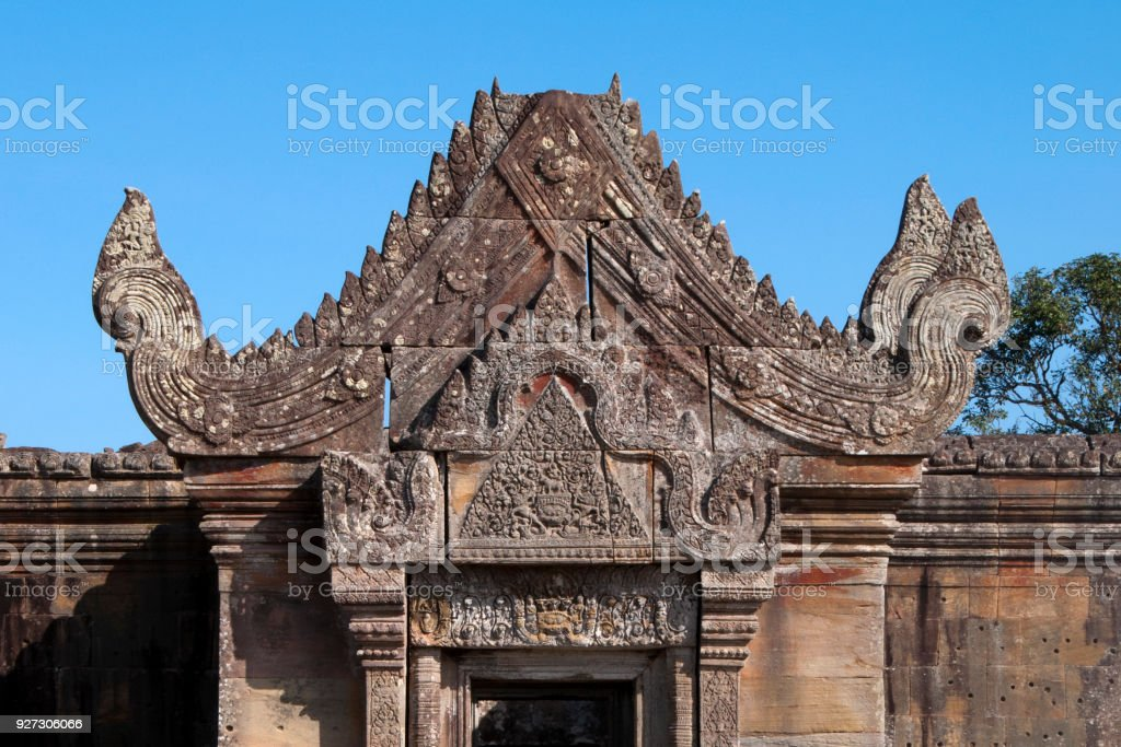 view of carved pediment and lintel over Gopura III entrance a the 11th century Preah Vihear Temple stock photo