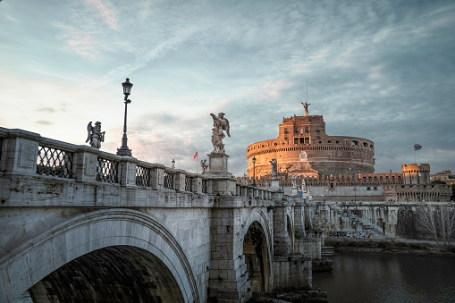 View of Castel Sant'Angelo and Tiber River at sunset