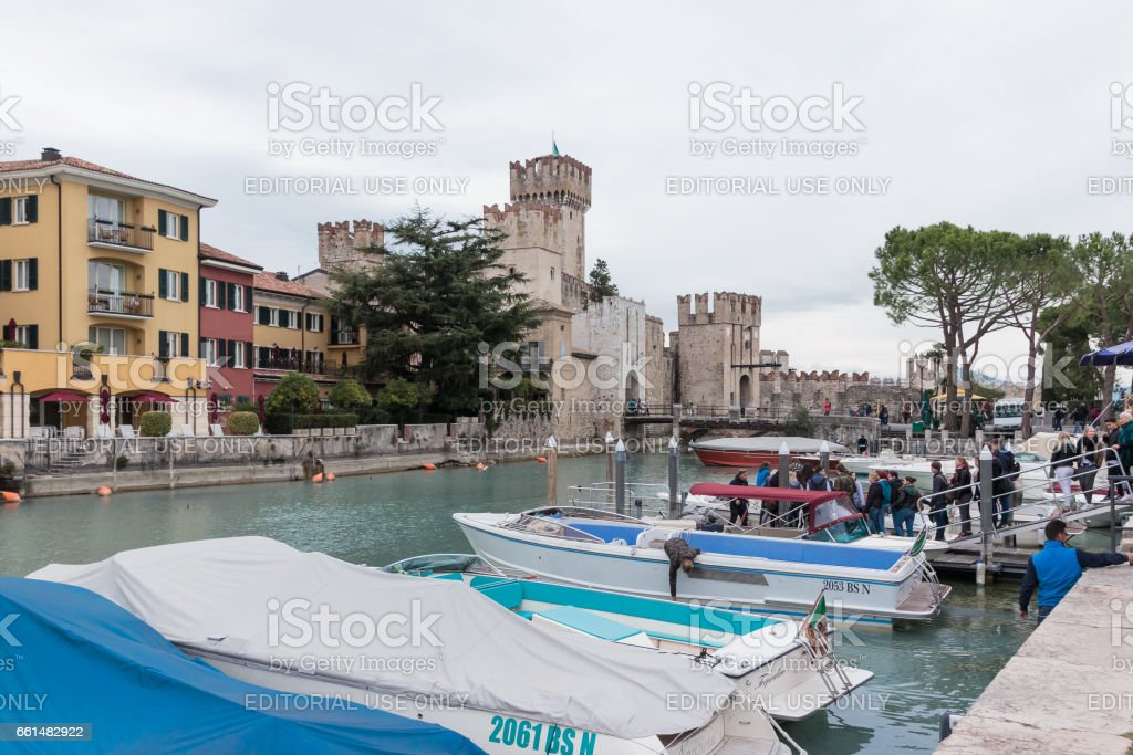 View of Castello Scaligero from the pier of Sirmione stock photo