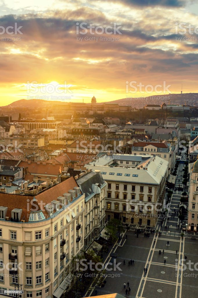 View of Castle Hill and Zrinyi Street in Budapest at sunset stock photo