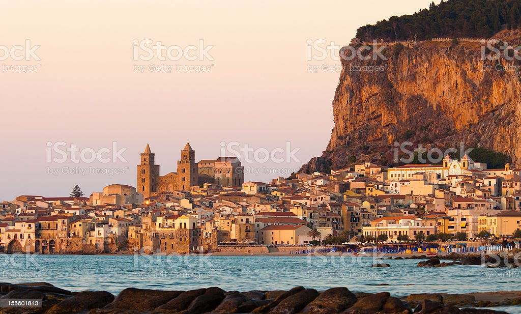 view of Cefalu cliff at dusk stock photo