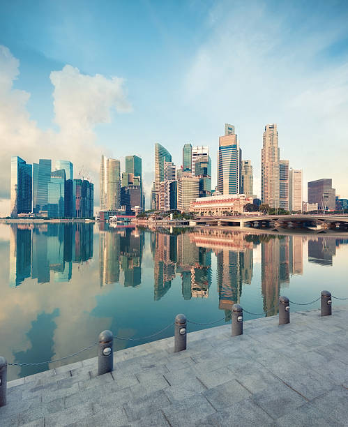 View of central Singapore Singapore central quay with reflection on foreground. Modern city architecture at sunrise. merlion fictional character stock pictures, royalty-free photos & images