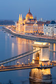 View of the Hungarian Parliament Building and the Chain Bridge in Budapest at dusk