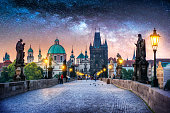 Composition of Charles Bridge in Prague at night with a milky way night sky. Czech Republic