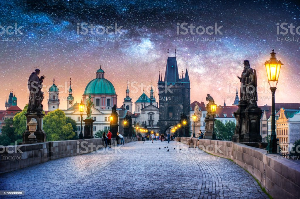View of Charles Bridge in Prague at night with milky way. Czech Republic stock photo
