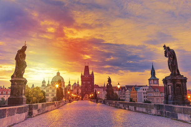 view of charles bridge in prague during sunset, czech republic. the world famous prague landmark. - чехия стоковые фото и изображения