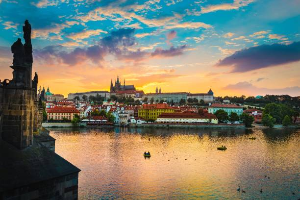 view of charles bridge in prague during sunset, river vltava czech republic. - чехия стоковые фото и изображения