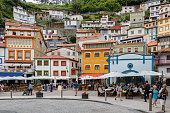 VIew of the charming and colorful village of Cudillero, in the province of Asturias, Northern Spain. The small town receives thousands of tourists every summer, attracted by the picturesque building facades and the local food.