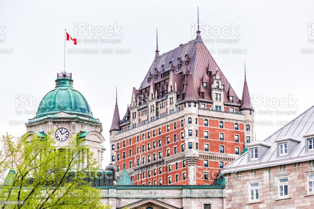 View of Chateau Frontenac by old town during summer with green trees stock photo