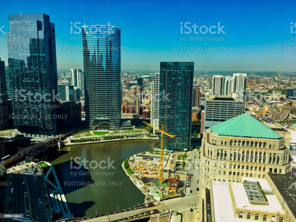 View of Chicago River seen from high up, with reflections of light bouncing off of the buildings onto the water as boats travel by. - Royalty-free Bridge - Built Structure Stock Photo