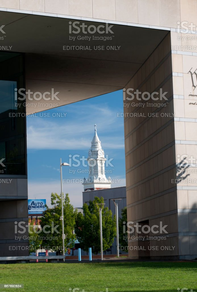 View of church tower through the building of National Constitution Center stock photo