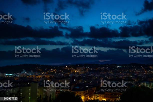 Photo of View of city at dusk