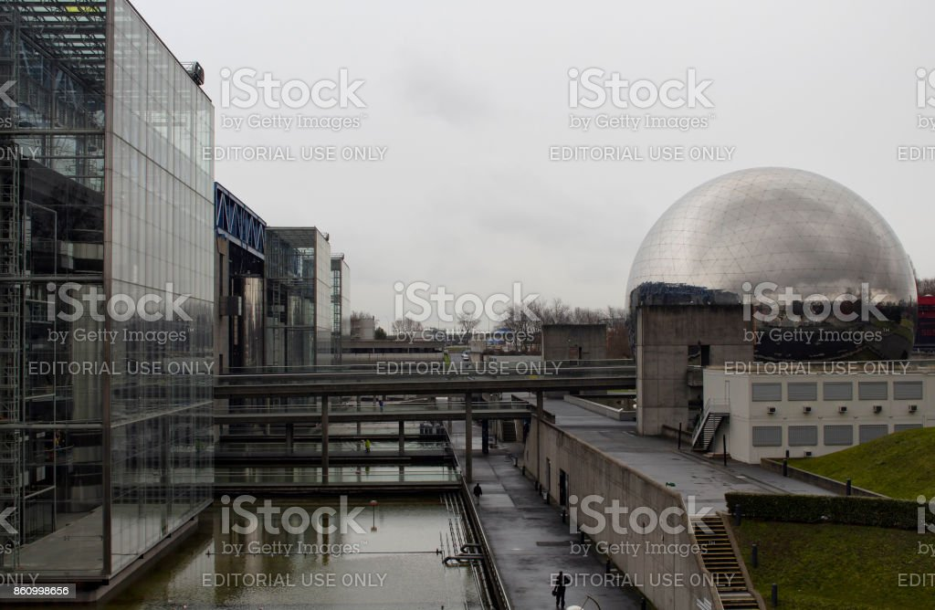 View of City of Science and Industry in Paris winter time. La Geode (modern cinema inside a mirror ball) is also in the view. It is located in Pont de Flandre park. stock photo