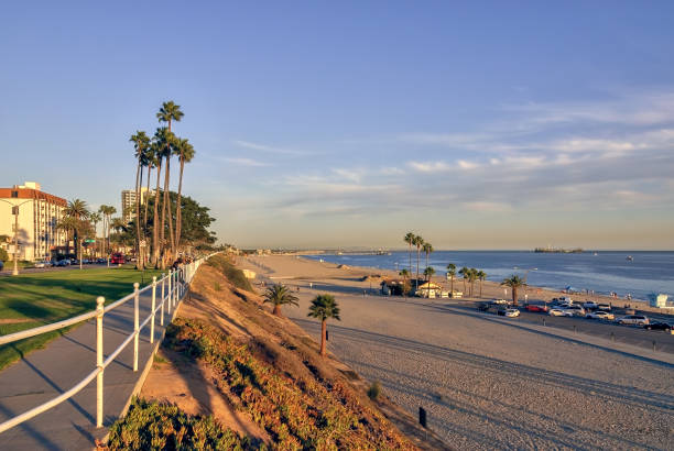 View of coastal Long Beach in Southern California. VIew of coastal Long Beach in Southern California at sunset, with sandy beaches and the blue Pacific ocean. long beach california stock pictures, royalty-free photos & images
