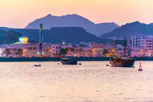 view of coastline of muttrah district of muscat during sunset, oman. - oman zdjęcia i obrazy z banku zdjęć