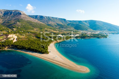 istock View of coastline with peninsula and town in Croatia, Bol town, Zlatni rat 1094604330