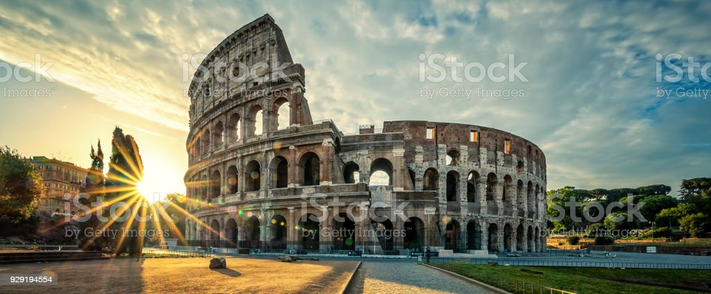 View of Colloseum at sunrise View of Colloseum at sunrise, Italy. Agricultural Field Stock Photo