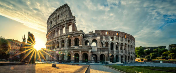 view of colloseum at sunrise - empire stock pictures, royalty-free photos & images