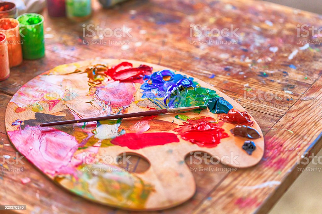 View of colorful palette with paintbrush on wooden table foto de stock royalty-free
