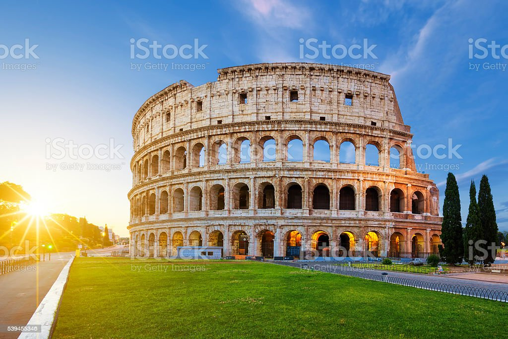 View of Colosseum in Rome at sunrise stock photo