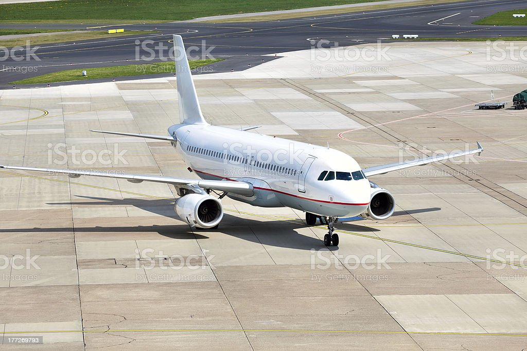 view of commercial airplane parking at an airport stock photo