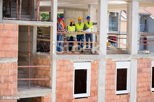 516607254istockphoto View of construction in progress with group of architects 516607408
