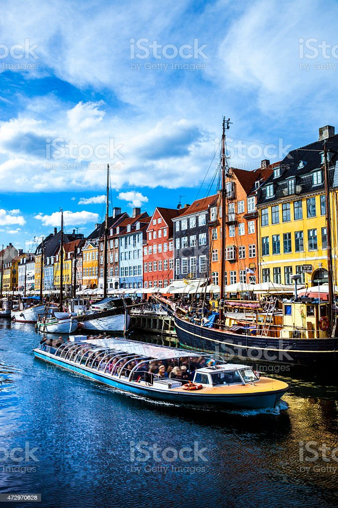 View of Copenhagen famous canal with boats and houses stock photo