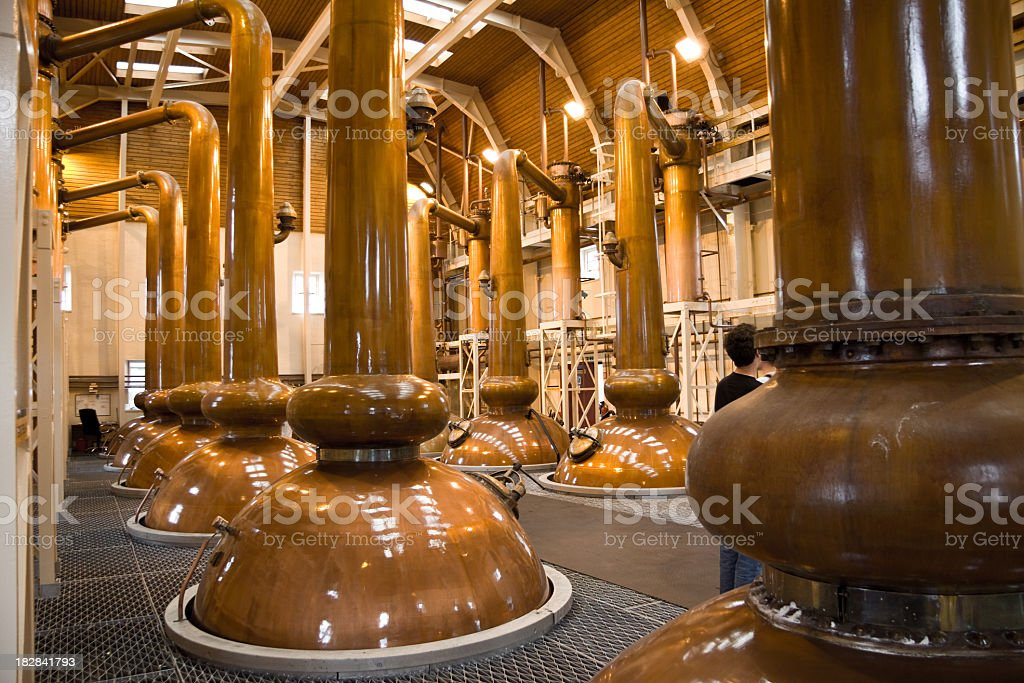 View of copper whiskey stills in a distillery stock photo