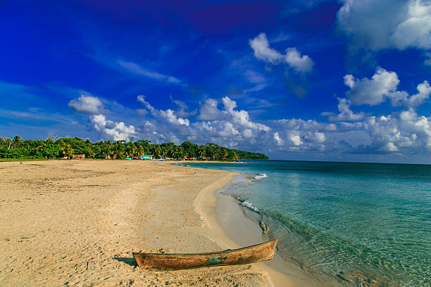 view of corn island Nicaragua. sea with boat blue sky stock photo
