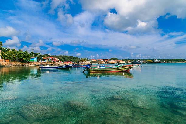 view of corn island Nicaragua. sea with boats, blue sky stock photo