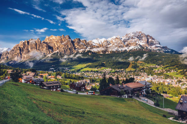 View of Cortina D'Ampezzo with Pomagagnon mount in the background, Dolomites, Italy, South Tyrol. View of Cortina D'Ampezzo with Pomagagnon mount in the background, Dolomites, Italy, South Tyrol. arezzo stock pictures, royalty-free photos & images
